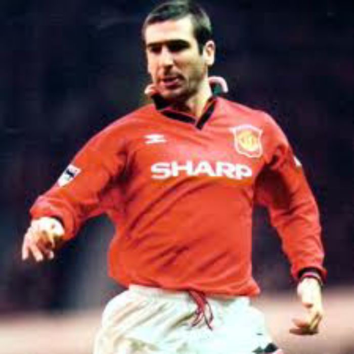 cantona in sharp shirt